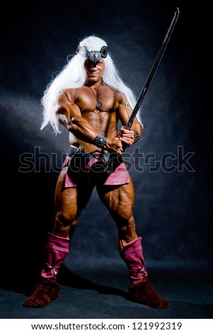 Muscular man with a sword and long white hair. The image of the warrior