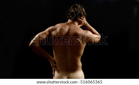 Muscular man with back pain
