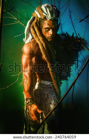 Muscular man with dreadlocks werewolf on a colorful background. Halloween. fabulous hero - stock photo