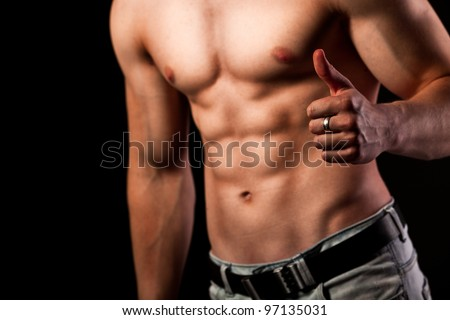 Muscular man with ok sign - stock photo