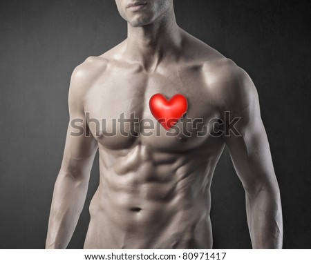 Muscular man with red heart