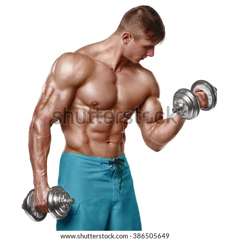 Muscular man working out doing exercises with dumbbells at biceps, strong male naked torso abs, isolated over white background - stock photo