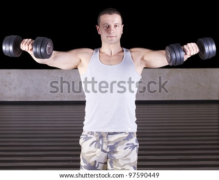 Muscular men exercising with weights. - stock photo