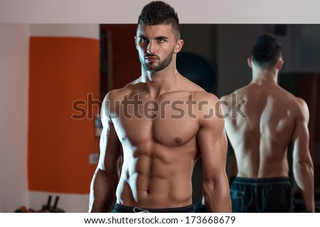 Muscular Men - Portrait Of A Physically Fit Muscular Young Man Without A Shirt