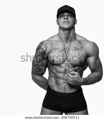Muscular men with tattos isolated on white - stock photo