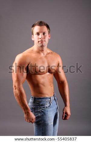 muscular model posing in studio - stock photo