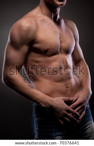 Muscular naked man - stock photo