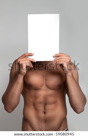 Muscular naked man holding white empty paper - stock photo