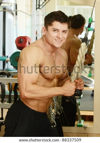muscular perfect male in a gym center