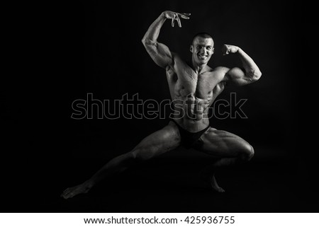 Muscular, relief bodybuilder on a black background