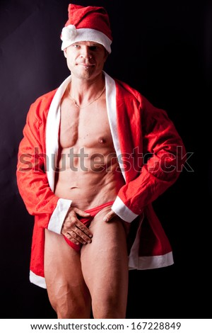 muscular santa claus posing in studio - stock photo