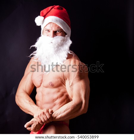 muscular santa claus posing in studio