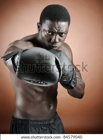 Muscular serious looking boxer training