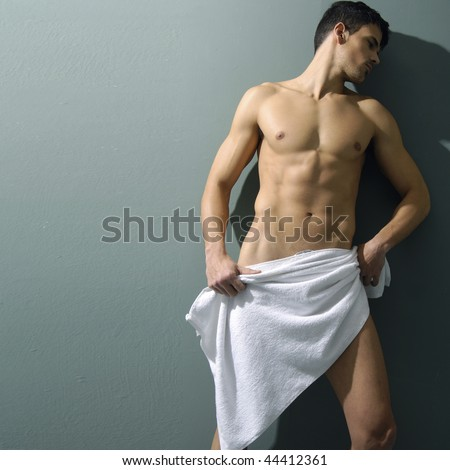 muscular sexy man covered with the towel - stock photo