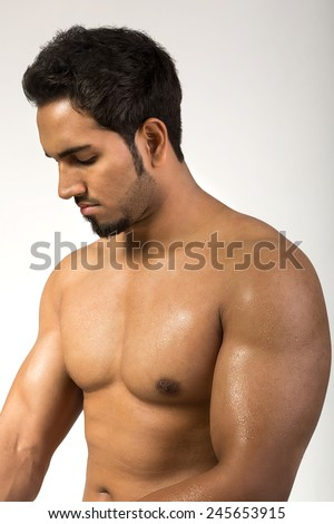 Muscular Sexy Man Flexing Biceps Isolated On White - stock photo