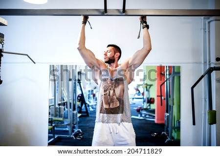 Muscular sexy man working out at gym - stock photo