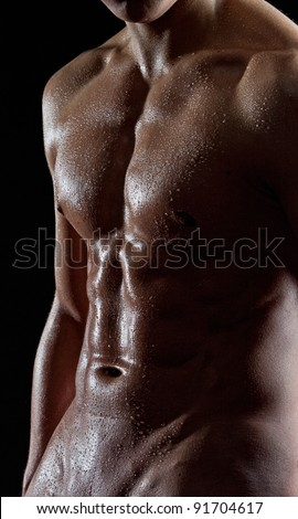 Muscular sexy nude wet male torso - stock photo