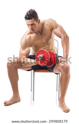 Muscular sexy shirtless young man exercising biceps with dumbbell, isolated on white - stock photo