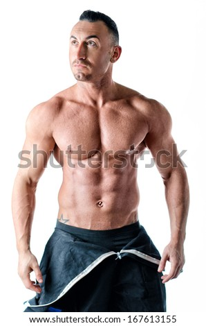 Muscular shirtless worker with coverall around waist, isolated on white