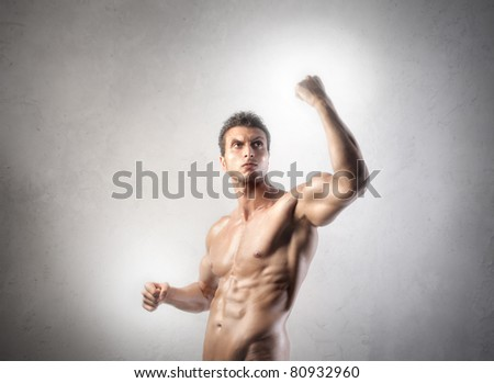 Muscular strong man - stock photo