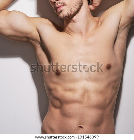 Muscular Torso. Naked, muscular torso of the athletic man.