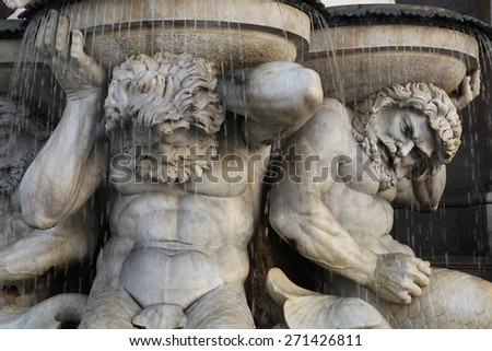 Muscular Tritones support the Danube Fountain or the Albrecht Fountain (1869) by Austrian sculptor Johann Meixner in front of the Albertina Museum in Vienna, Austria.  - stock photo