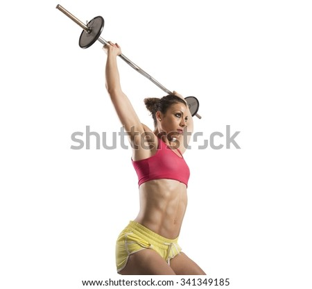 Muscular woman doing hard workout with barbell