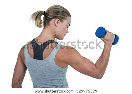 Muscular woman working out with dumbbells on white background