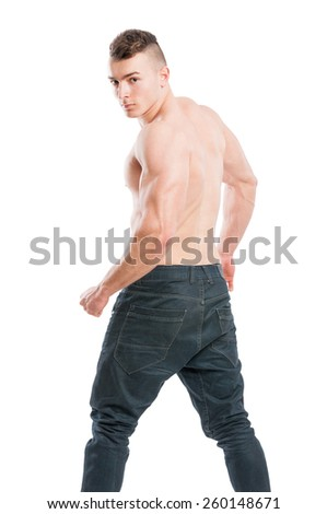 Muscular, young  and handsome male turning to the camera wearing jeans and shirtless - stock photo