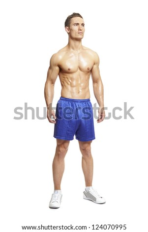 Muscular young man flexing muscles in sports outfit on white background - stock photo