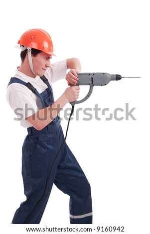 Muscular young man in a builder uniform with tools. - stock photo