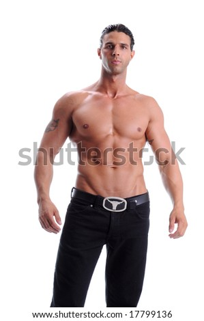 Muscular young man standing in black jeans