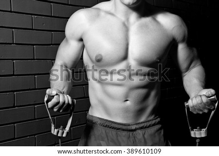 Muscular young sexy nude man on studio.Men burned body in the gym - stock photo