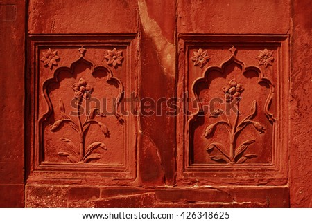 Museum entrance with carved walls in Red Fort, Old Delhi, India - stock photo
