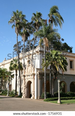 Museum exterior with palm trees in front