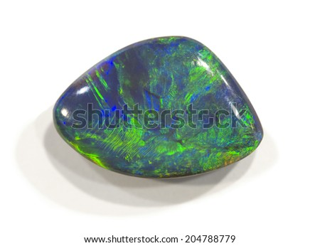 MUSEUM MINERAL SERIES: Polished opal from Lightning ridge, Australia. Isolated on white, 2cm across. - stock photo