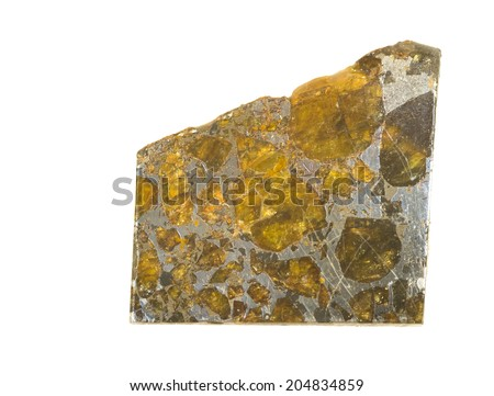 MUSEUM MINERAL SERIES: Polished slice of Pallasite meteorite found in Belarus in 1810. Crystals of Olivine in an iron-nickel matrix. Isolated on white,  4cm across. - stock photo