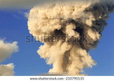 MUSHROOM CLOUD FROM TUNGURAHUA VOLCANO EXPLOSION IN ECUADOR, SOUTH AMERICA  - stock photo
