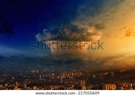 Mushroom cloud look like nuclear bomb explosion over big town - stock photo