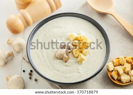 Mushroom cream soup in a bowl served for lunch, French food, top view