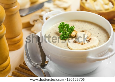 Mushroom cream soup on a table, food - stock photo
