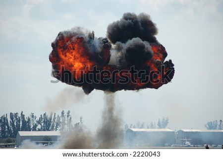 Mushroom explosion outdoors with fire and black smoke - stock photo