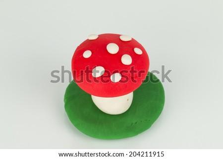 Mushroom from children bright plasticine - Stock Image macro. - stock photo
