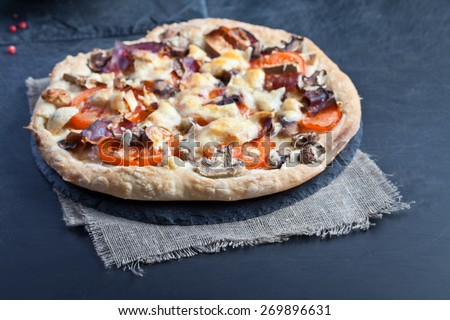 Mushroom pizza topped with basil leaves - stock photo
