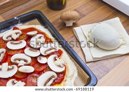 Mushroom pizza with buffalo mozzarella (mozzarella di bufala) - stock photo
