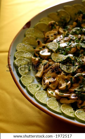 Mushroom salad whit lemon - stock photo