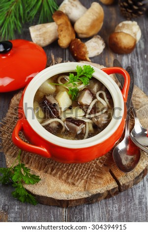Mushroom soup in the pot on the table