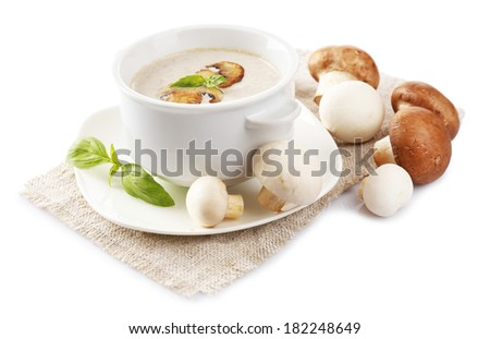 Mushroom soup in white bowl, on napkin, isolated on white - stock photo