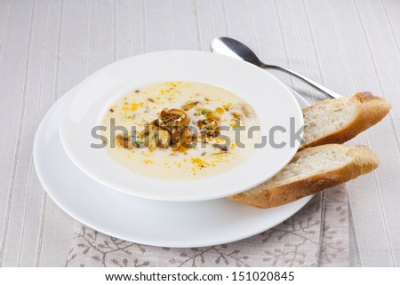 mushroom soup with bread and wine - stock photo