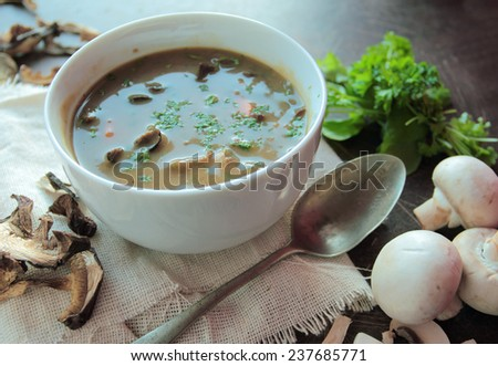 Mushroom soup with fresh champignons and parsley - stock photo